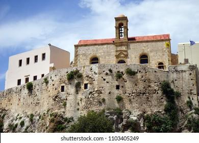 INNACHORI, GREECE - CIRCA MAY 2018 Chrysoskalitissa Monastery. 17th-century Orthodox Christian monastery overlooks the Libyan Sea.