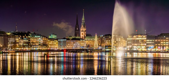 The Inner Alster Lake (German: Binnenalster) in Hamburg, Germany. 4k Panoramic view of the inner city and the town hall (German: Rathaus) at night.