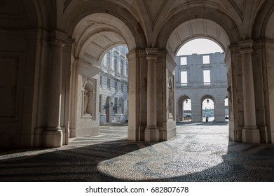 Inner arches of historical building against light form drawings and contrasts traced by doors and windows, an interesting and beautiful scene, in the city of Lisbon, Portugal, May 2017.
