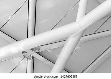 Inner ceiling structure with steel beams and white panels. Abstract industrial architecture background photo