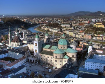 The inner city of Salzburg is separated by the Salzach river. The old sovereignty (Old Town) is located on the left riverbank. Salzburg Cathedral is in the middle of the picture.