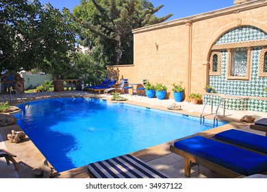 The inner courtyard with a swimming pool in Moroccan hotel.