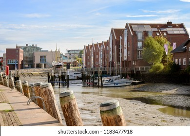 inner harbor at low tide in the old town of Husum on a sunny day, north sea coast in germany, selected focus