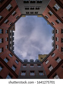 Inner octagonal famous modern architecture by italian architect Aldo Rossi in Berlin, courtyard wide view looking up with blue sky on a sunny evening