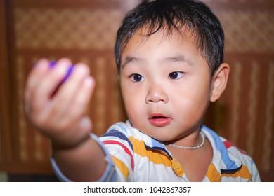 Innocent little asian boy.
