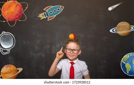 Innovation in astronomy. Education for kids at school. Funny little boy with finger up  has idea.