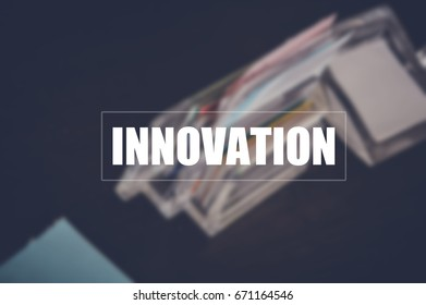 innovation with blurring notepapers on desk in office background