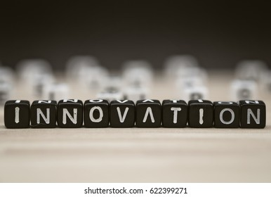 INNOVATION, by black alphabet beads