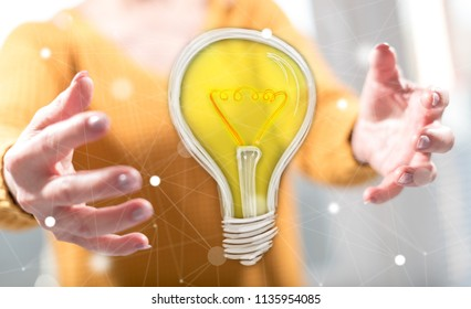 Innovation concept between hands of a woman in background