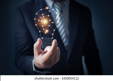 Innovation and creative market concept, business man holding bright light bulb in hand of imagination power