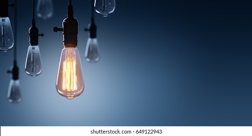 Innovation And Leadership Concept - Glowing Bulb On Among Bulbs Off