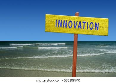 Innovation sign on beach background