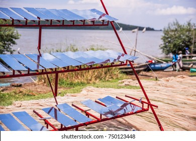 Innovative community members at Bao Beach, a remote fishing village on the shores of Lake Victoria, Kenya, have developed a frame to support simple solar panels to harvest sunlight for electricity.