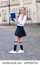 Innovative lifelong learning. using headset technology. small happy girl listen e-book. pupil in retro uniform listen audio book. e-learning. vintage kid fashion. old school music. back to school.