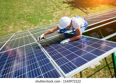 Innovative solar panels installing by professional mounter. High-tech exterior, modern equipment, ecological friendly, green energy. Innovative electricity saving, using renewable energy of sun.