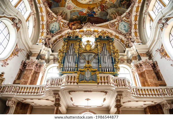 Innsbruck, Austria - 07 23 2020 Baroque organ and beautiful ceiling of Innsbruck Cathedral or the Cathedral of St. James
