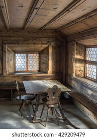 INNSBRUCK, AUSTRIA - 13 MAY 2016: Tiroler Volkskunstmuseum (Museum of Tyrolean Regional Heritage). The interior of the room in traditional tyrolean peasant house - wooden table, carved hardwood chair
