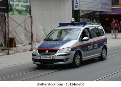 INNSBRUCK, AUSTRIA - AUGUST 18, 2013: Volkswagen Austrian Police van in the capital of Austria's western state of Tyrol street.