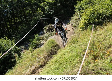 INNSBRUCK, AUSTRIA - AUGUST 29, 2015: Fully equipped professional biker is riding a mountain bike downhill style on Nordkette Alp mountain chain during the Nordkette Downhill Pro Competition.