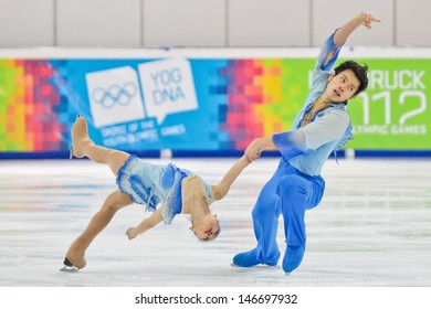 INNSBRUCK, AUSTRIA - JANUARY 16 Xiaoyu Yu and Yang Jin (China) win the pairs figure skating event on January 16, 2012 in Innsbruck, Austria.
