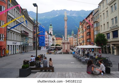 INNSBRUCK, AUSTRIA - JULY 7, 2013. Street view on Maria-Theresien-Strasse in Innsbruck, with Annasaule column erected in 1703 to mark the repulsing of a Bavarian attack.