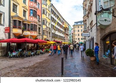 INNSBRUCK, AUSTRIA - JUNE 23, 2016: Street in historical part of Innsbruck in a beautiful summer day, Austria on June 23, 2016