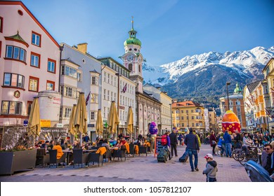 INNSBRUCK, AUSTRIA - March 2018: Innsbruck town center with lots of people and street cafes decorated for Easter holidays with big Easter eggs, Innsbruck, Tyrol, Austria