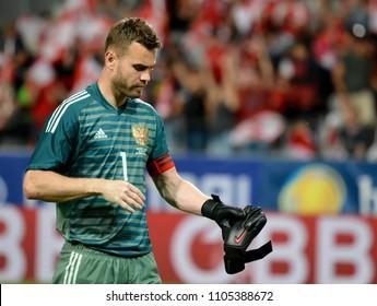Innsbruck, Austria - May 30, 2018. Russian goalkeeper Igor Akinfeev taking off his gloves after international friendly Austria vs Russia.