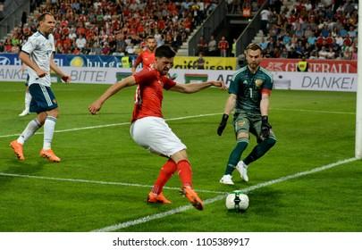 Innsbruck, Austria - May 30, 2018. Austrian midfielder Florian Grillitsch against Russian goalkeeper Igor Akinfeev and defender Sergey Ignashevich during international friendly Austria vs Russia.
