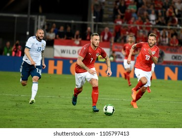 Innsbruck, Austria - May 30, 2018. Austrian players Marko Arnautovic and Guido Burgstaller with Russian defender Fedor Kudryashov during international friendly Austria vs Russia.