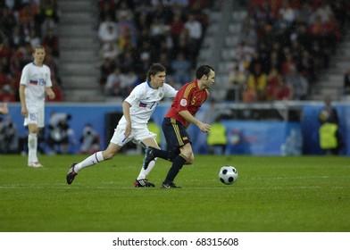 INNSBRUCK - JUNE 10: Andr�©s Iniesta of Spain (in red) & Dmitri Torbinskiy of Russia (in white)  during the match Spain-Russia 4:1 Euro2008 Group D. June 10, 2008, in Innsbruck, Austria