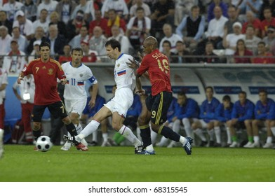 INNSBRUCK - JUNE 10: Marcos Senna of Spain (in red) & Konstantin Zyryanov of Russia (in white) during the match Spain-Russia 4:1 Euro2008 Group D. June 10, 2008, in Innsbruck, Austria
