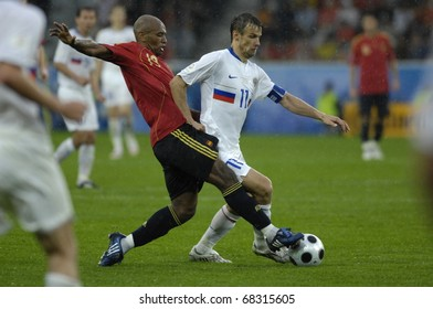 INNSBRUCK - JUNE 10: Sergei Semak of Russia (in white) & Marcos Senna of Spain (in red)  during the match Spain-Russia 4:1 Euro2008 Group D. June 10, 2008, in Innsbruck, Austria