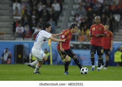 INNSBRUCK - JUNE 10: Yuri Zhirkov of Russia (in white) & Santi Cazorla of Spain (in red)  during the match Spain-Russia 4:1 Euro2008 Group D. June 10, 2008, in Innsbruck, Austria