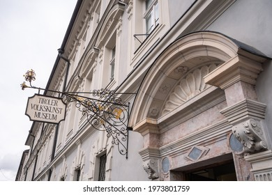 Innsbruck, Tyrol, Austria - February 8 2021: Tiroler Volkskunstmuseum, the Museum of Tyrolean Folk Art Entrance and Sign in the New Abbey or Neues Stift.