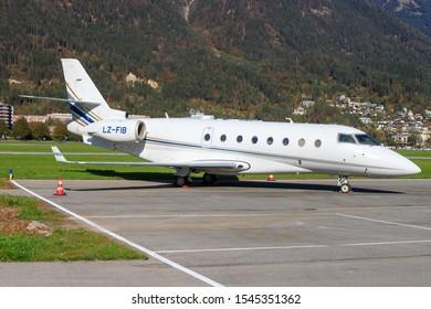 Innsbruck/Austria October 26, 2019: Balkan Holidays Gulfstream Aerospace G200 at Innsbruck Airport.