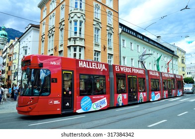 INNSBRUK, AUSTRIA AUGUST 24 -distinctive red tram that runs through the city -  August 24 2015 in Innsbruk Austria
