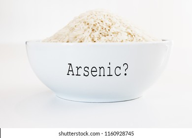 Inorganic Arsenic in rice - white bowl on white background
