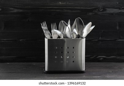 Inox cutlery. Spoon and fork. Stainless steel. Monocrome style photo