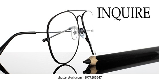 INQUIRE text. Glasses and pencil isolated on the white background