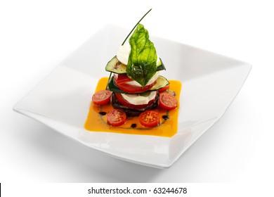 Insalata Caprese - Italian salad, made of Tomatoes, Zucchini and Buffalo Mozzarella Cheese