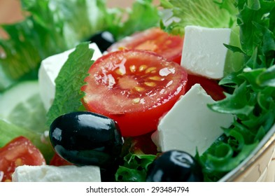 Insalata di misticanze  -  leaves of different salads with vegetables and Sicilian tomatoes
