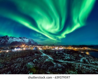 An insane Aurora Borealis display over the fishing village of Henningsvaer, Lofoten Islands, Arctic Norway.