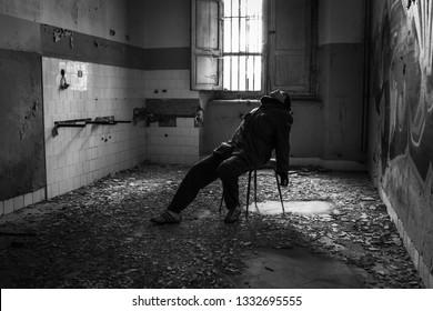 Insane man inside Ferri building, the judicial psychiatric hospital special area.  Abandoned asylum of Volterra (manicomio di Volterra), Tuscany, Italy 18/12/2011. This hospital was shut down in 1978.
