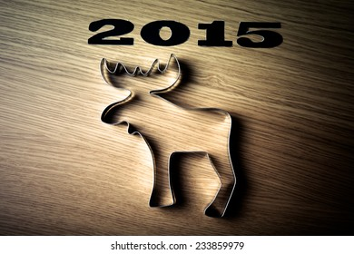 Inscription 2015 form of moose on a wooden table