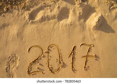 The inscription 2017 on the beach