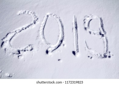 Inscription 2019 on the snow, simbol of new year 2019.