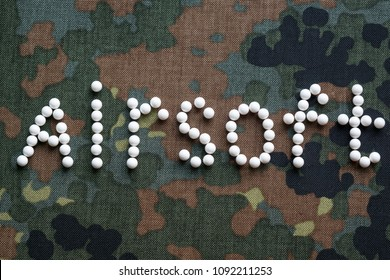 inscription airsoft plastic balls bbs on camouflage fabric