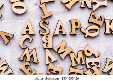Inscription ASAP as soon as posisioble abbreviation in wooden letters on a light background.