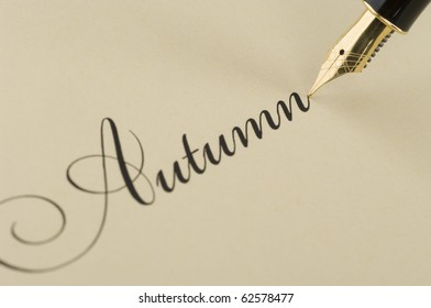 Inscription Autumn with gold pen